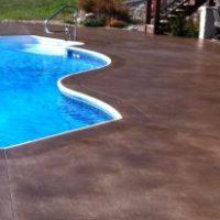pool-decks-spellbinding-acid-stain-concrete-pool-deck-with-brown-stain-concrete-pool-for-vinyl-liner-pool-designs-also-stainless-steel-swimming-pool-handrails-600x206